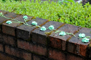 blue frosting flowers on brick