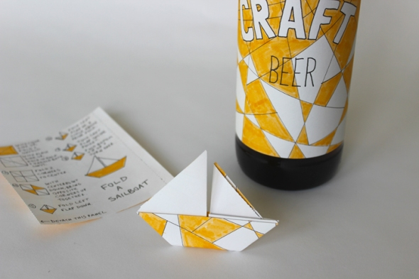 origami sailboat beer label